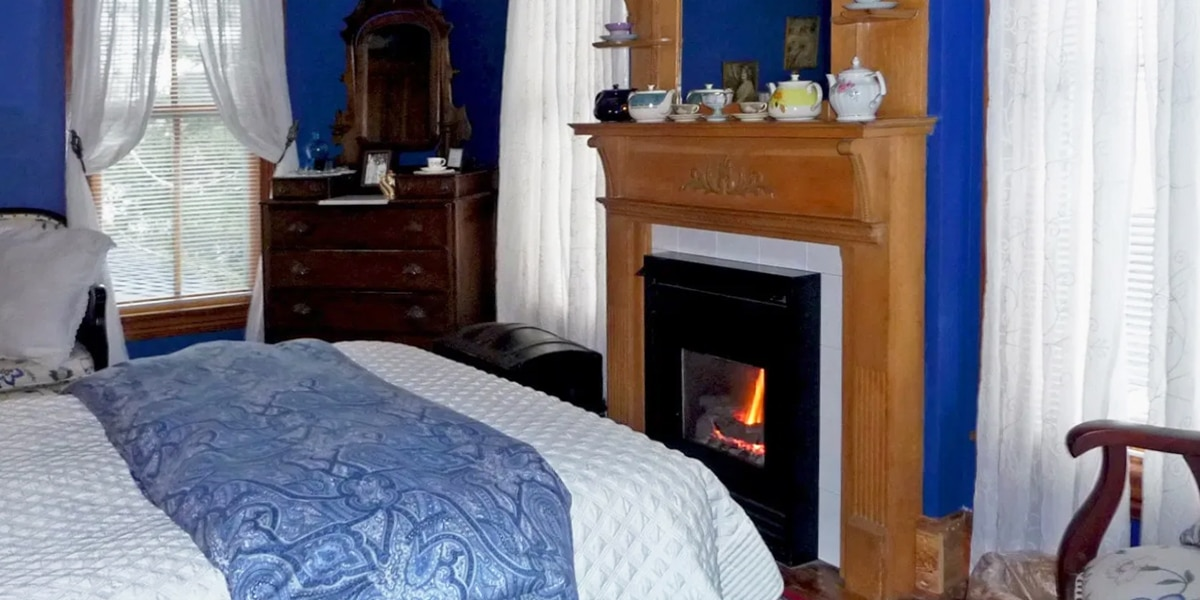 Cobalt Suite bed, dresser and fireplace